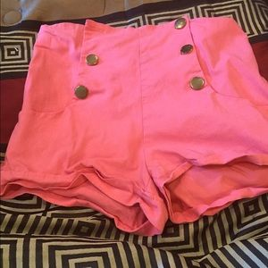 Coral high waisted shorts.