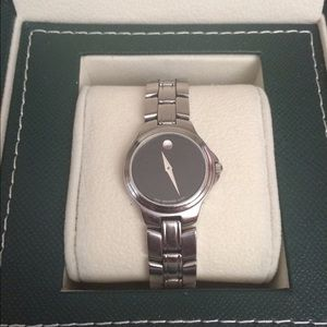 Movado ladies stainless steel museum wristwatch.