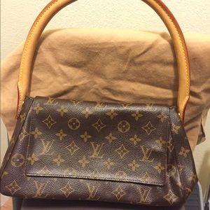 1fdfda02d987 Louis Vuitton Bags - Authentic Louis Vuitton mini looping bag