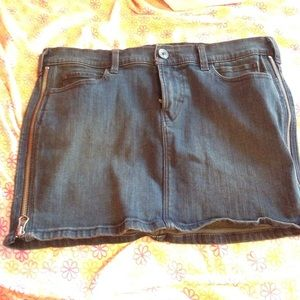 Denim skirt with zippers on sides
