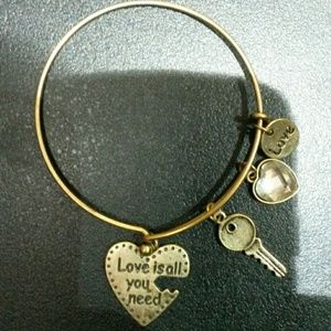 Charm bracelet.  Antique  gold
