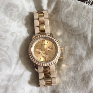 A gold and cream watch.