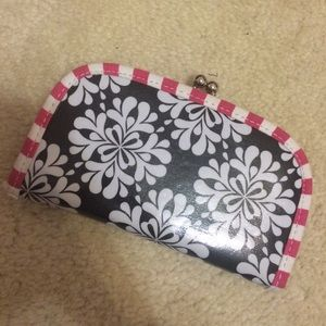 Shiny pink brown and white floral clutch