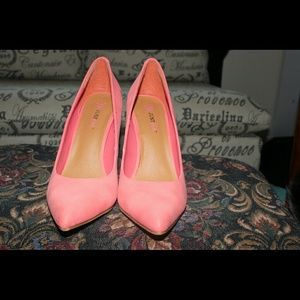 Coral or peach colored heels.