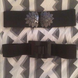 2 black elastic waste belts.