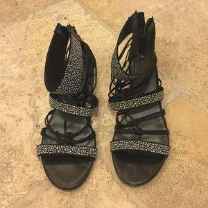 Black Nine West sandals with silver bubble studs