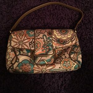 Floral Cole Haan bag with brown leather strap