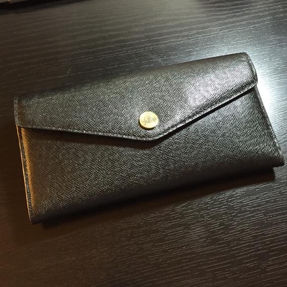 e7aeaadcf4f4 Michael Kors Saffiano envelope wallet. M_551240177fab3a54e90021a8