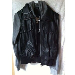 Black leather vest attached with grey sleeves