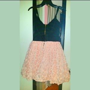 Mini dress with pink ruffle flowers