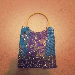 Sequin embroidered bag with wooden handles