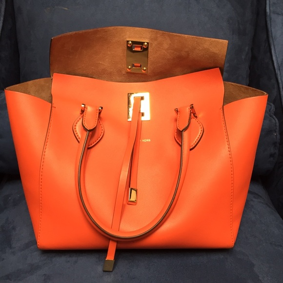 8b2bd2c4327d Michael Kors Miranda Tote in Orange. M 55206c85028fee25710015ff