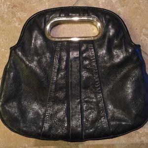 Handbags - little black clutch.