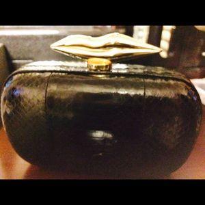 DVF Snakeskin clutch purse