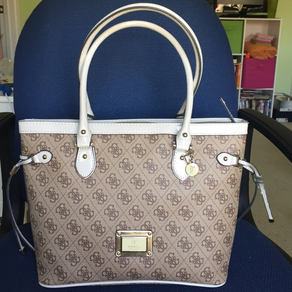 Beige Guess Tote with gold accents and brown