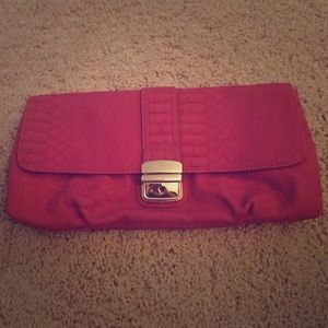 Express red clutch. Never used.