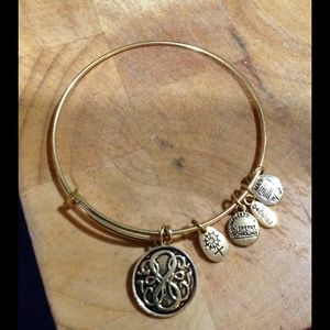 Path of Life .  antique gold tone charm bracelet.
