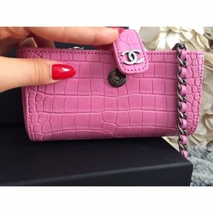 Chanel Small pink alligator clutch bag w/chains.