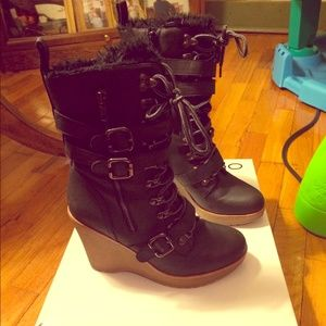 Black wedge boots by Aldo