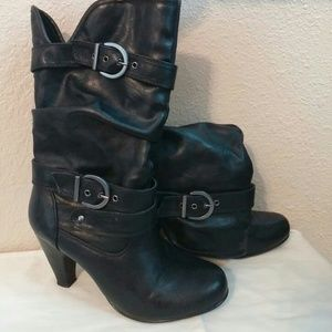 Black high heel boots with buckle