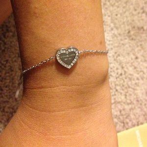 549fd0851026d Michael Kors Jewelry - Michael Kors Silver Heart Bracelet with Crystals