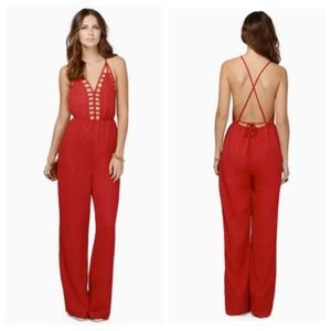 Red cut out jumpsuit. Backless.