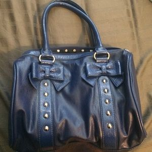 Blue purse with bows