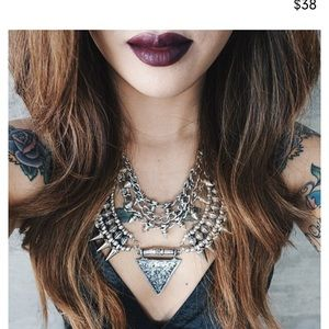 Just wing it necklace as seen on heyclaire