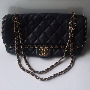 Chanel lambskin purse with chain detail.