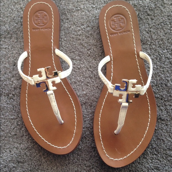 bea1d79b4 Tory Burch Lowell logo thong sandals size 6. M 5533e0a55a7f9739fe0656c1.  Other Shoes you may like