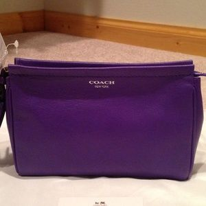 Brand new with tags Coach legacy large wristlet.