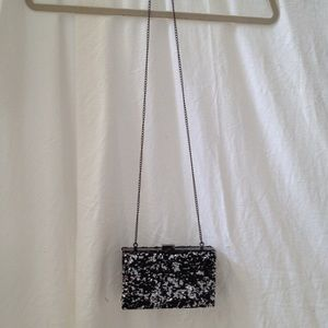 Black & silver sequin clutch with chain strap