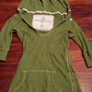 Green hooded shirt front pocket