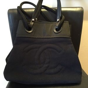 CHANEL Black canvas tote & backpack.  NWT d c box