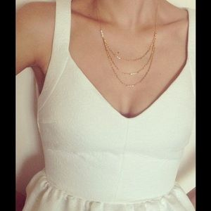 Triple layered gold with pearl necklace