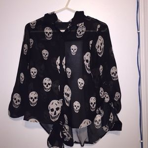 A black and white skull blouse