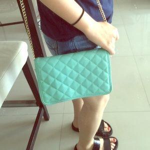 Small chain messenger bag