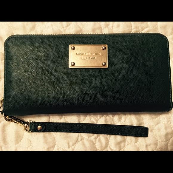 9eaea4c12991 Michael Kors dark green wallet. M_553d25a8729a6637ab00bcbb