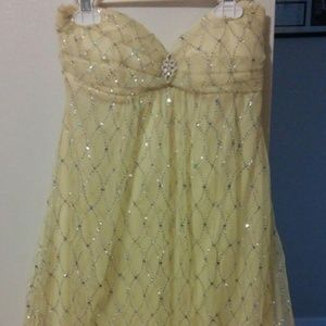 Short yellow sparkly dress