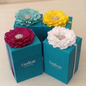 Four Tieks boxes with flowers.