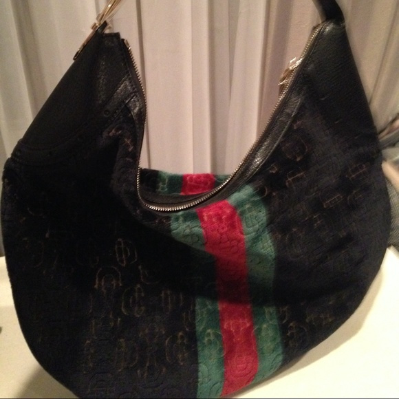 gucci used. authentic gucci laser cut bag, very gently used g