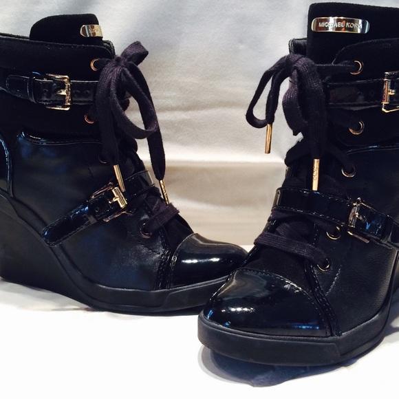 0d7fe721ad4 Michael Kors Black Skid Wedge Sneaker. M 554380e1c402ae200f004a06