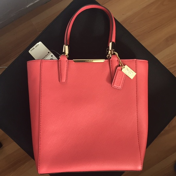 42% off Coach Handbags - Coral colored coach bag from Brandy's ...