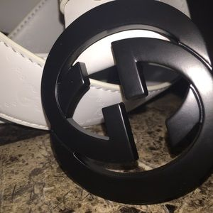 All white Gucci belt with black buckle