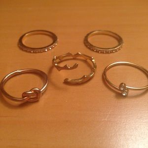 Assortment of dainty gold rings [4]