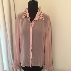Sheer buttoned shirt with spike collar.