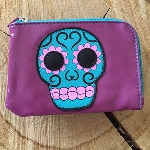 Wallet with a skull candy front