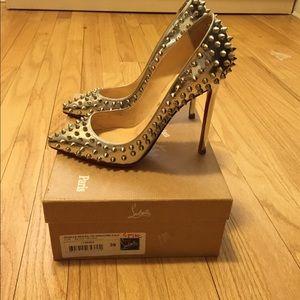 Christian Louboutin spike heels...