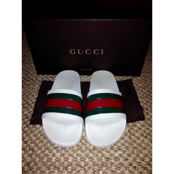fb50d8b181be Gucci Shoes - Authentic Gucci white rubber slide sandal
