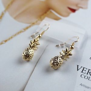 Gold pineapple earrings statement